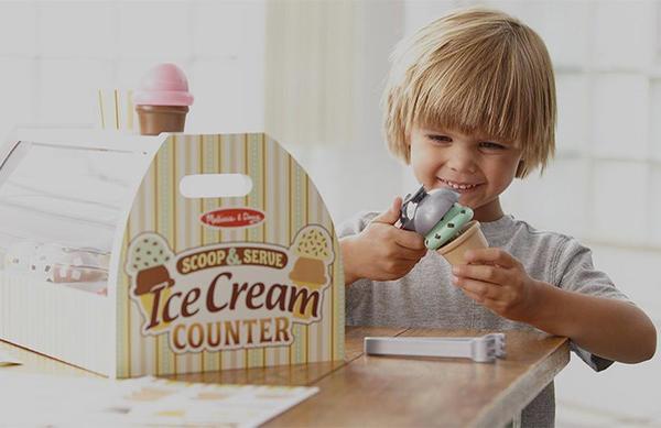 child playing with melissa & doub ice cream playset